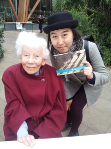 Rosalie Huzzard, founder of Sheffield WILPF poses with a 21-year old student from China at the WILPF 100th Anniversary exhibition in Sheffield Winter Gardens